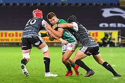 Luca Sperandio of Benetton Treviso is tackled by Dan Evans of Ospreys<br /> <br /> Photographer Craig Thomas/Replay Images<br /> <br /> Guinness PRO14 Round 4 - Ospreys v Benetton Treviso - Saturday 22nd September 2018 - Liberty Stadium - Swansea<br /> <br /> World Copyright © Replay Images . All rights reserved. info@replayimages.co.uk - http://replayimages.co.uk