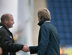 Gus MacPherson, manager of Queen of the South and Steven Pressley, Falkirk manager at the end..Falkirk 1 v 0 Queen of the South, 15/10/2011..Pic © Michael Schofield.
