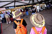 Sisters (11 years old, 8 years old) with Akubra hats and frangipani leis, at Kona International Airport. Big Island, Hawaii