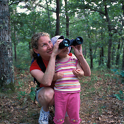 Harwich, MA.A woman and her daughter explore a trail in the oak-pine forest near the Monomoy River (a.k.a. Muddy Creek) in Harwich on Cape Cod.