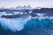 Splashing wave on reefs along Wellington coast