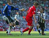 Photo. Andrew Unwin, Digitalsport<br /> NORWAY ONLY<br /> <br /> Liverpool v Newcastle United, FA Barclaycard Premier League, Anfield, Liverpool 15/05/2004.<br /> Liverpool's Harry Kewell (c) and Newcastle's Darren Ambrose (r) have a disagreement.