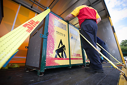 © London News Pictures. 23/06/2013. Hythe, Kent, UK.(EMBARGO UNTIL 24/06/13). A transportation crate is secured to the DHL lorry. A critically endangered western lowland gorilla family from Port Lympne Wild Animal Park are bound for Gabon in Africa as part of The Aspinal Foundation's Back to the Wild campaign. Djala, a 30 year old silverback, four mothers and four offspring embark on a unique 6,000 mile journey back to the wild courtesy of its partners DHL. Picture credit Manu Palomeque/LNP
