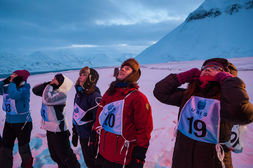 UNIS students watch as flare guns are fired at a shooting range outside Longyearbyen, Svalbard. The university center's basic safety training focuses on polar bear encounters and snowmobile driving. Pictured (l-r): Ingunn Farsund, Ellen Nissen, Marianne Andresen, Heidi Rosendahl Lindebotten, and Eleanor Jones.