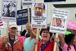 June 3, 2017 - San Juan Capistrano, California, United States - June 3, 2017_San Juan Capistrano, California_USA_| In front of the theater at San Juan Hills High School anti-Trump and Issa protesters get noisy before the Representative Issa Town Hall Meeting. Middle with two signs is Joan Pond, of Carlsbad. |_Photo Credit: Photo by Charlie Neuman (Credit Image: © Charlie Neuman via ZUMA Wire)