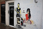 Street art mural to the deceased pop singer Amy Winehouse and Dave Gahan of Depeche Mode on 14th January 2020 in London, England, United Kingdom. Amy Winehouse, was found dead at her London home following years of drug and alcohol abuse largely attributed to her troubled character and fame.