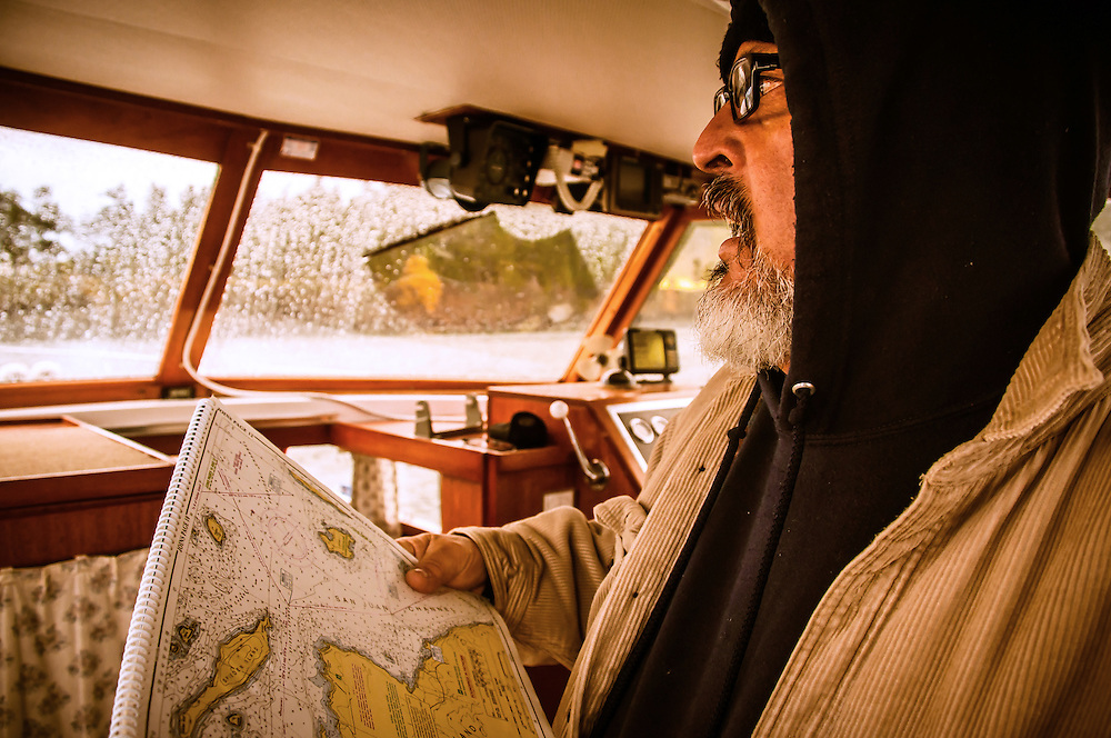 Portrait of The Navigator  Captain of the ship with navigation charts<br /> www.vianajulia.com