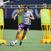 Kaka (10) dribbles the ball during the Orlando City Soccer club MLS practice at the Florida Citrus Bowl on Wednesday, March 4, 2015 in Orlando ,Florida. The first season for the Lions is scheduled to begin on March 8, and over 60,000 tickets have been sold for the home opener, though a league wide player strike may occur prior to the beginning of the scheduled season. (AP Photo/Alex Menendez)