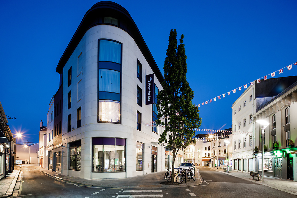 The Premier Inn Hotel and streets of St Helier town deserted at dusk.