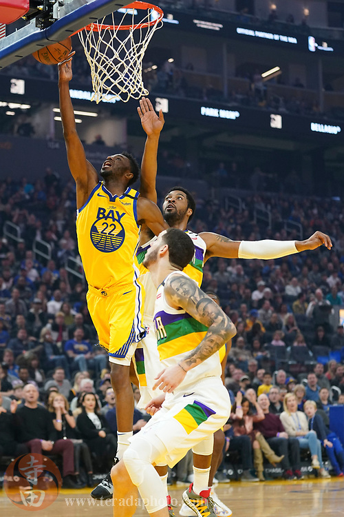 February 23, 2020; San Francisco, California, USA; Golden State Warriors guard Andrew Wiggins (22) shoots the basketball against New Orleans Pelicans guard Lonzo Ball (2) during the first quarter at Chase Center.