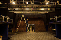 """Neil Pankhurst checking out some lighting as the stage begins preparations for the upcoming production """"Rocky Horror Show"""" to start the Summer Professional Theater events at Winnipesaukee Playhouse.  (Karen Bobotas/for the Laconia Daily Sun)"""