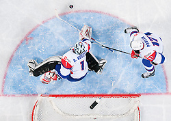 Andrej Hocevar of Slovenia and Ziga Pavlin of Slovenia during ice-hockey match between Slovenia and Japan at IIHF World Championship DIV. I Group A Slovenia 2012, on April 16, 2012 in Arena Stozice, Ljubljana, Slovenia. Slovenia defeated Japan 4-2. (Photo by Vid Ponikvar / Sportida.com)