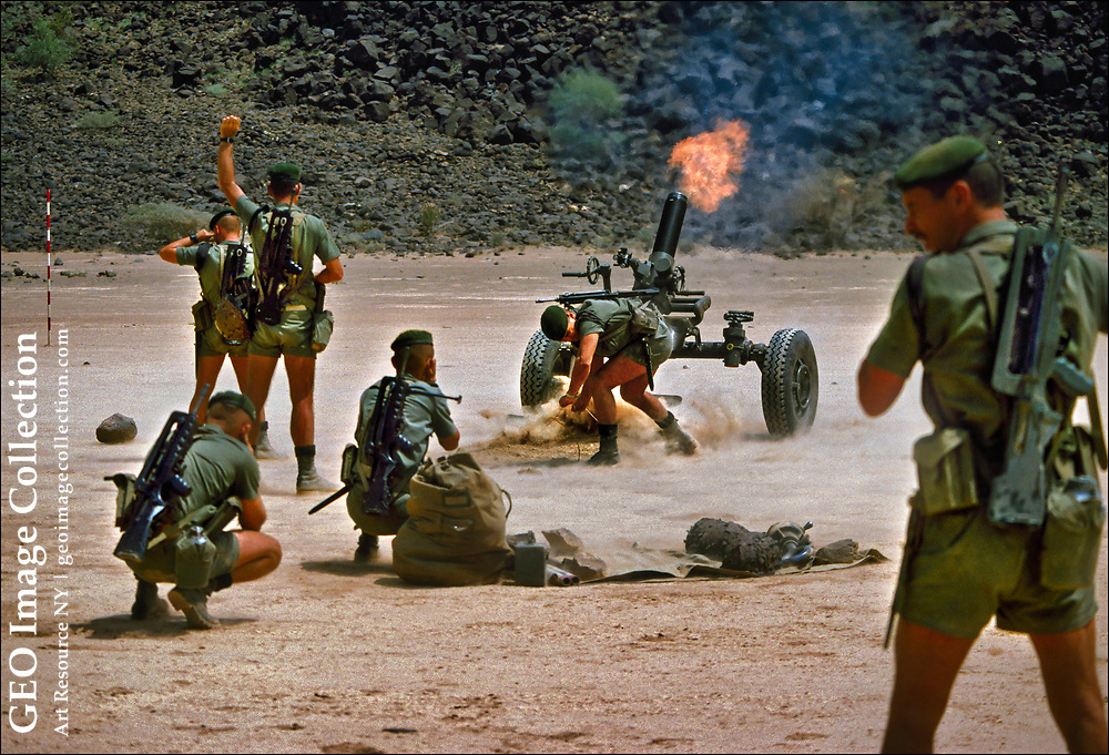French Foreign Legionnaires of the 13th Demi Brigade fire a 120mm heavy mortar in the Djibouti desert near the border with embattled Ethiopia. Both France and the United States maintain military bases in Djibouti aimed at fighting Islamic extremists and terrorists in Africa.