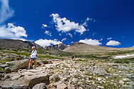 Hikers descending the trail from Longs Peak in Rocky Mountain National Park, Colorado.