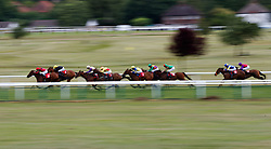 Island of Life (far left) ridden by James Doyle on the way to winning The Randox.com Handicap during Randox Health Gentlemen's Day at Sandown Park Racecourse, Esher.