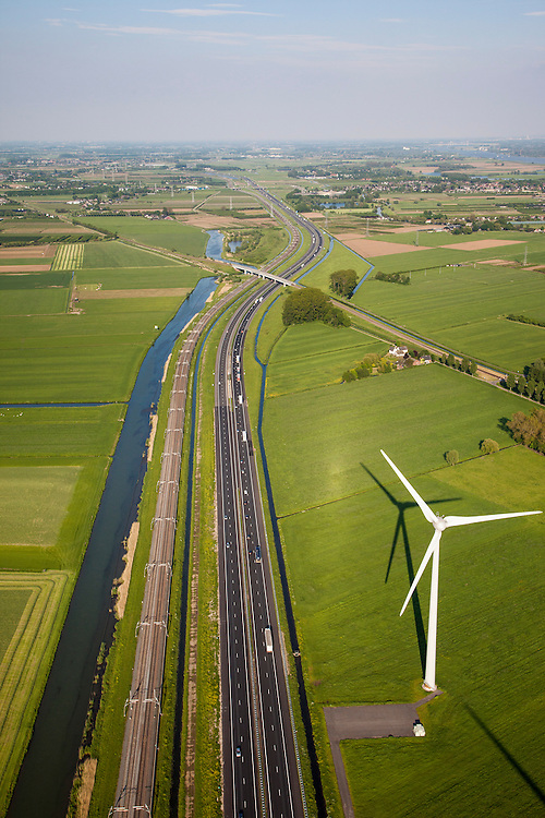 Nederland, Gelderland, Echteld, 27-05-2013;<br /> infrabundel: Rivier de Linge, Betuweroute en A15, windmolen. Spoorlijn Tiel-Elst (Betuwelijn)<br /> Motorway A15 together with freight railroad.<br /> luchtfoto (toeslag op standard tarieven)<br /> aerial photo (additional fee required)<br /> copyright foto/photo Siebe Swart
