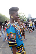 August 23, 2015- Brooklyn, NY-United States:  Concert Goers attend the 2015 AFROPUNK Festival on August 23, 2015 held at Commodore Barry Park in Brooklyn, New York City.  AFROPUNK is an influential community of young, gifted people of all backgrounds who speak through music, art, film, comedy, fashion and more. Originating with the 2003 documentary that highlighted a Black presence in the American punk scene, it is a platform for the alternative and experimental.  (Terrence Jennings/terrencejennigs.com)