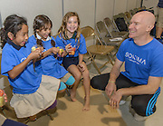 Sonima Foundation Program Director Eddie Stern interacts with Oak Forest Elementary School students during the Sonima Foundation Health and Wellness program with HISD on 09/23/14. ( photo by Kim Christensen)