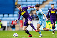 Derby County midfielder Max Bird  (8)  battles for possession with Callum O'Hare of Coventry City during the EFL Sky Bet Championship match between Coventry City and Derby County at the Coventry Building Society Arena, Coventry, England on 23 October 2021.