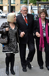 Rolf Harris arrives at Southwark Crown Court, London, UK, with his daughter Bindi Nicholls (left) and niece Jenny (right).<br /> <br /> Tuesday 3rd June 2014.<br /> Picture by Ben Stevens / i-Images