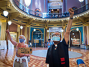 12 JUNE 2020 - DES MOINES, IOWA: Black Lives Matter supporters participate in a protest in the rotunda of the Iowa capitol. About 75 activists from Black Lives Matter came to the Iowa State Capitol in Des Moines Friday to talk to Iowa Governor Kim Reynolds. They've been trying to meet with Gov. Reynolds all week. She made time for them Friday and met with 5 representatives of the organization without any media in the room. They wanted to talk to her about police violence against African-Americans and racial disparities in Iowa's justice system. While the 5 met with the Governor, the remaining activists picketed the hall in front of her office and chanted.    PHOTO BY JACK KURTZ