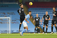Burnley forward Chris Wood (9) heads clear during the Premier League match between Manchester City and Burnley at the Etihad Stadium, Manchester, England on 28 November 2020.