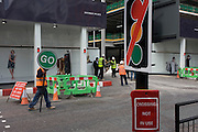 Construction workmen with a 'Stop Go' sign to help traffic flow plus a coincidental 'no lights' sign at a closed crossing.