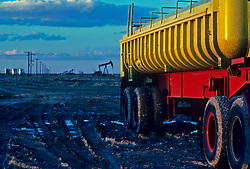 Stock photo of yellow transport truck at a work site