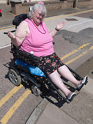 Wheelchair user unable to get up high kerb..(Not cleared for newspaper and television use)