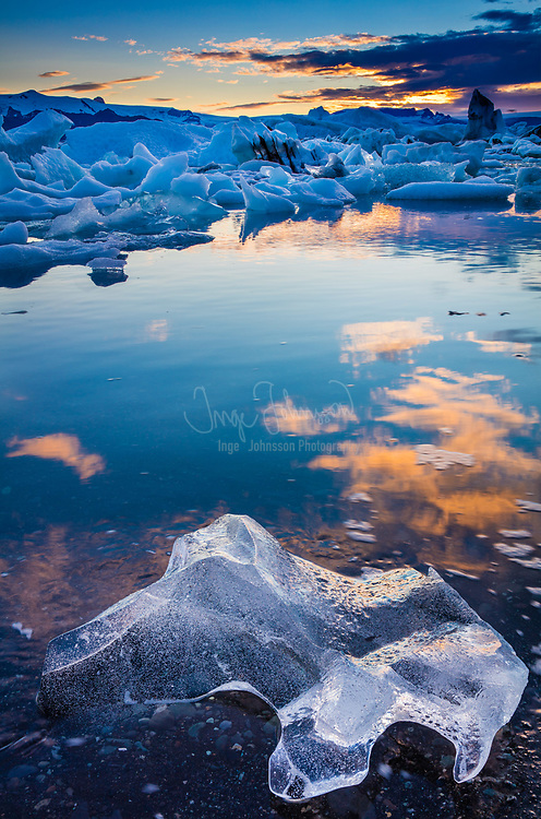 Jökulsárlón is a large glacial lake in southeast Iceland, on the edge of Vatnajökull National Park. Situated at the head of the Breiðamerkurjökull glacier, it developed into a lake after the glacier started receding from the edge of the Atlantic Ocean. The lake has grown since then at varying rates because of melting of the glaciers. It is now 1.5 kilometres (0.93 mi) away from the ocean's edge and covers an area of about 18 km2 (6.9 sq mi). It recently became the deepest lake in Iceland, at over 248 metres, as glacial retreat extended its boundaries. The size of the lake has increased fourfold since the 1970s. It is considered as one of the natural wonders of Iceland