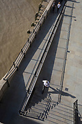 An aerial view of Londoners walking in the shadows of Fishmongers Hall Wharf in the City of London, on 10th October 2018, in London, England.