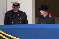 Queen Elizabeth II and the Duke of Edinburgh during the annual Remembrance Sunday Service at the Cenotaph memorial in Whitehall, central London.