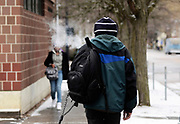 A man walks along State Street in downtown Ithaca, NY, Friday, March 4, 2016. The City of Ithaca recently unveiled a new drug policy calling for supervised heroin injection sites and heroin maintenance therapy, which are pieces of the four pillars of change proposed. (Heather Ainsworth for The New York Times)