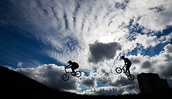 Riders are silhouetted against the sky during the men's 1/8 finals during day ten of the 2018 European Championships at the Glasgow BMX Centre Track.