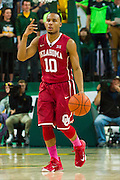 WACO, TX - JANUARY 24: Jordan Woodard #10 of the Oklahoma Sooners brings the ball up court against the Baylor Bears on January 24, 2015 at the Ferrell Center in Waco, Texas.  (Photo by Cooper Neill/Getty Images) *** Local Caption *** Jordan Woodard