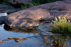 Stock photo of boulders forming the bank of the Llano River in the Texas Hill Country