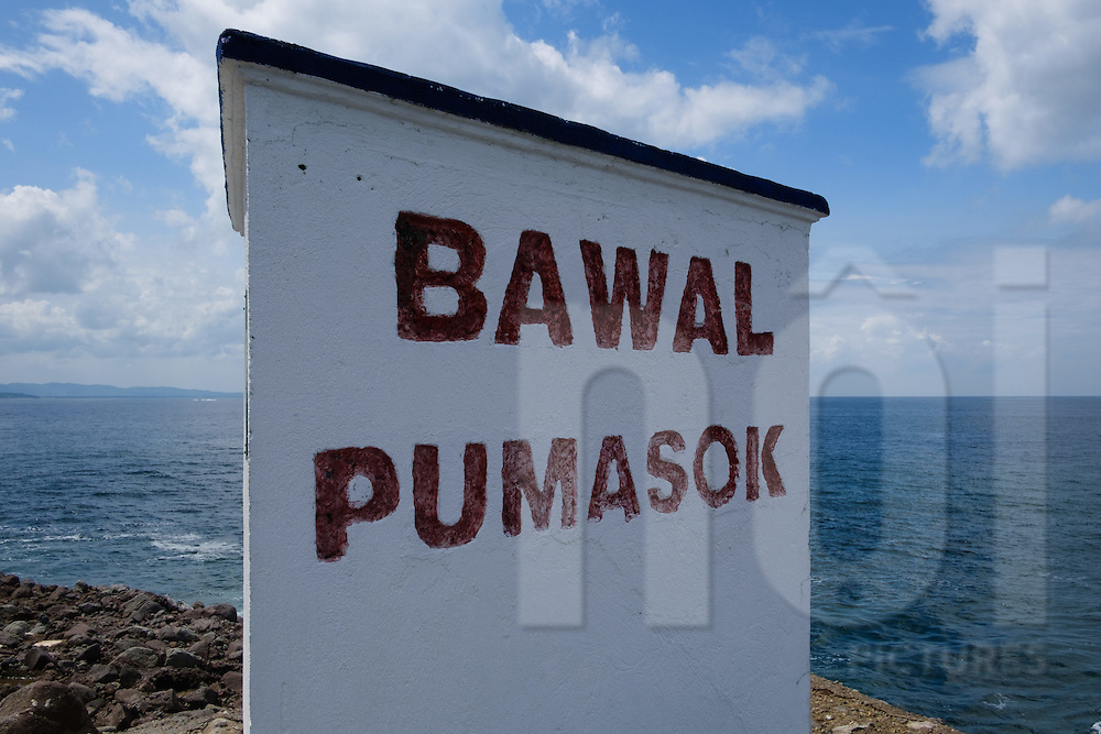 No entry sign (written in Tagalog) along a shore in Punta Fuego, Batangas, Philippines, Southeast Asia