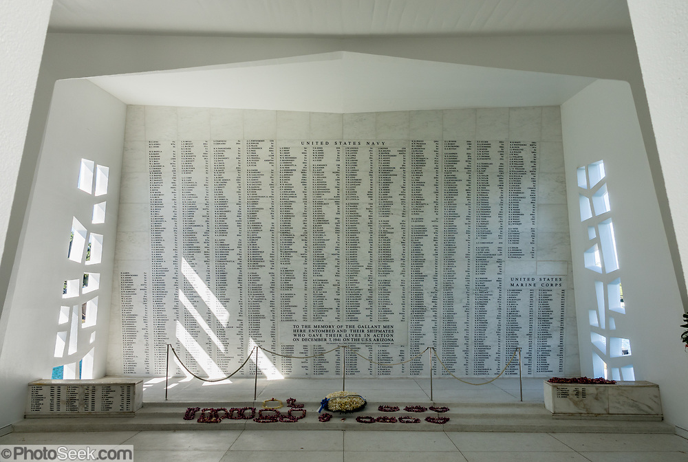 Shrine Room of the USS Arizona Memorial, built in 1962 at Pearl Harbor, Oahu, Hawaii, USA. The USS Arizona Memorial marks the watery grave of 1102 sailors and Marines killed onboard that battleship during the Japanese surprise attack on Pearl Harbor, 7 December 1941. The attack united a divided America to join World War II. More than two million people per year visit the USS Arizona Memorial, which is part of  the World War II Valor in the Pacific National Monument, run by the National Park Service. Reached only via boat, the memorial straddles but doesn't touch the sunken hull. USS Arizona (BB-39) was a Pennsylvania-class battleship launched by the United States Navy in 1916. A Japanese bomb violently exploded a powder magazine and sank the ship, killing 1177 officers and crewmen. This shipwreck shrine is a National Historic Landmark.