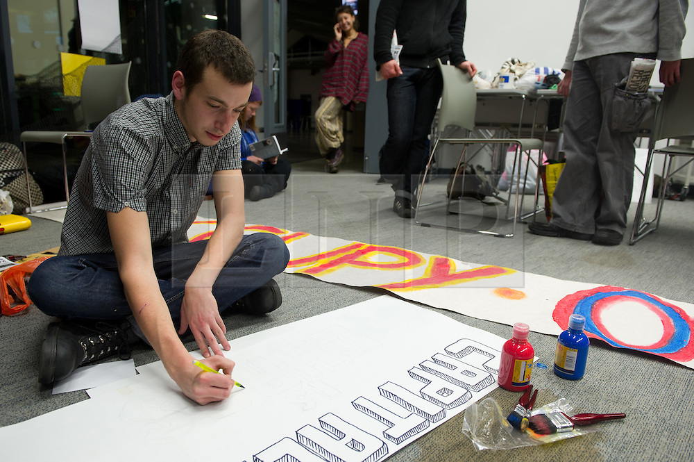 © under license to London News Pictures.  23/11/2010 A student makes a banner the night before (Tuesday) national demonstrations over the UK . University of Plymouth students occupy a room in the University in protest against the proposed rise in fees. Picture credit should read: David Hedges/London News Pictures.