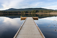 The swimming dock at Whonnock Lake Park in Maple Ridge, British Columbia, Canada.  Blue Mountain is in the background.