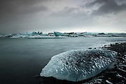 A snow-covered and beached iceberg at the lagoon at Jökulsárlón in South-East Iceland