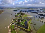 Nederland, Gelderland, Gemeente Zaltbommel; 25-02-2020; Poederoijen, kasteel en fort Loevestein bij hoogwater. In de achtergrond het Munnikenland, overloopgebied. Slot Loevestein is strategisch gelegen op de plaats waar Waal en Maas in het verleden samenkwamen (nu Afgedamde Maas.) Loevestein maakt deel uit van de Hollandse Waterlinie.<br /> Loevestein castle at high waters is strategically located at the place where Waal and Meuse in the past came together. Loevestein is part of the Holland Waterline (defense line).<br /> <br /> luchtfoto (toeslag op standard tarieven);<br /> aerial photo (additional fee required)<br /> copyright © 2020 foto/photo Siebe Swart