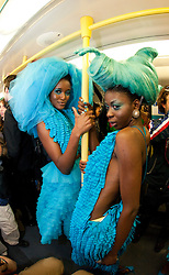 © licensed to London News Pictures. London, UK  08/06/2011. 19 models wearing turquoise dresses designed by Pierre Garroudi hit Central London and London Underground (Jubilee Line) in a flashmob today, Wed. 8 June.  Please see special instructions for usage rates. Photo credit should read Bettina Strenske/LNP