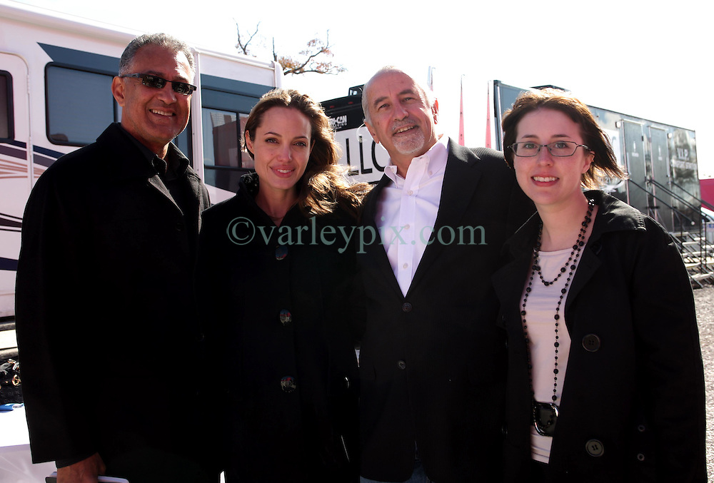 Dec 03 2007. New Orleans, Louisiana. Lower 9th Ward.<br /> Brad Pitt revisits the Lower 9th ward, devastated by Hurricane Katrina to present 'Make it Right' where architects' designs are unveiled to the public. Angelia Jolie  with Winning design Architects, L/R Gerald Billes, (Angelia Jolie) Richard Kravet and Erin Porter of Billes Architecture.<br /> Photo credit; Charlie Varley.