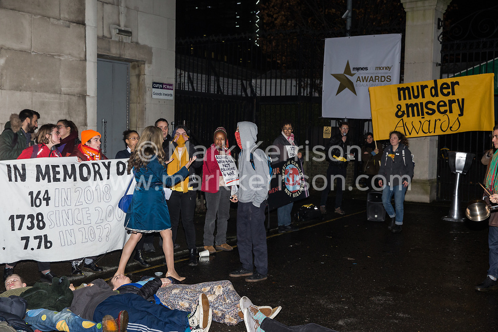 London, UK. 26 November, 2019. Activists from Global Justice Rebellion and London Mining Network hold a 'Muder & Misery Awards' protest outside the Mines and Money awards ceremony at the Honorary Artillery Company which is attended by mining company delegates, investors and government representatives. The activists were protesting to highlight the environmental impact of mining and also the manner in which mining companies are increasingly attempting to 'greenwash' their activities by claiming that they are indispensable in a transition to sustainables.