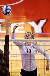 07 November 2014:  Emily Schneider lightly flips the ball over the net in a volley save during an NCAA womens volleyball match between the Loyola Ramblers and the Illinois State Redbirds at Redbird Arena in Normal IL