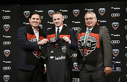 English international soccer player Wayne Rooney poses with Jason Levien, United Managing Partner and CEO<br /> and Dave Kasper , United General Manager and VP of Soccer Operations during the media unveiling at the Newseum in Washington, DC.