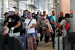 A group of South Africans nationals arrive at Miami International Airport to board a special charter flight by South African Airways on Tuesday, April 14, 2020. Amid the coronavirus pandemic, the flight will repatriate more than 300 South African workers who were supposed to spend these months working at South Florida hotels and resorts. Photo by Pedro Portal/Miami Herald/TNS/ABACAPRESS.COM