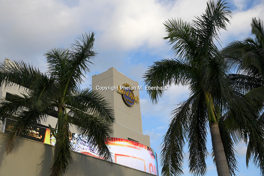 Palm trees frame the Seminole Hard Rock Hotel & Casino, Friday, Oct. 27, 2017, in Hollywood, Fla. (Photo by Phelan M. Ebenhack)