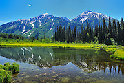 Mountain reflection on the Stewart Cassiar Highway<br /> <br /> near Bell ll<br /> British Columbia<br /> Canada